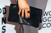 Meghan Markle matched her nail polish to her gray dress when she attended InStyle and HFPA's TIFF party.