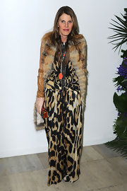 Anna dello Russo teamed a fur scarf with a printed evening dress for a more glam finish during the Givenchy fashion show.