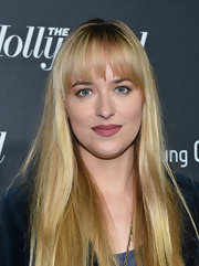 Dakota Johnson wore her long, straight hair down with wispy bangs during the Next Gen Class of 2012 event.