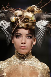 Daisy Lowe sported an elaborate nature-inspired headdress while walking the Pam Hogg Fall 2011 show.