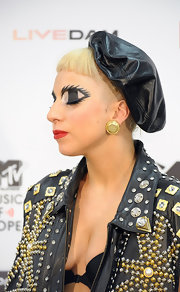 Lady Gaga teamed a black leather beret with a studded jacket for the MTV Video Music Aid Japan.