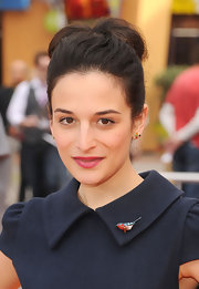 Jenny Slate finished off her ensemble with colorful gemstone studs.