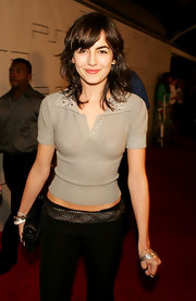 Camilla Belle styled her casual outfit with a metallic woven belt for the Pret a PSP event.