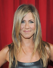 Jennifer Aniston kept her beauty look low-key yet sweet with a glossy pink lip.