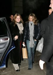 Jennifer Aniston teamed her jacket with blue bootcut jeans.