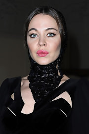 A beaded black choker/headpiece added major drama to Ulyana Sergeenko's look during the Jean Paul Gaultier fashion show.