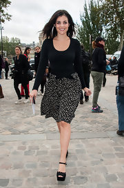 Julia Restoin-Roitfeld paired her top with a black-and-white confetti-print skirt.