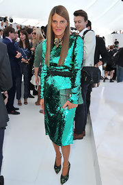 Anna dello Russo looked downright fab in an aqua-blue sequined dress by Dolce & Gabbana during the Louis Vuitton fashion show.