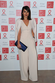 Miroslava Duma styled her outfit with an elegant blue satin clutch.