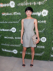 Kim Nguyen chose a no-frills gray mini dress for the Couture Council Fashion Visionary Awards.