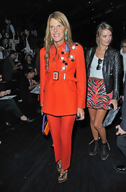 Anna dello Russo was '70s-chic in a red-orange Prada pantsuit during the Viktor & Rolf fashion show.