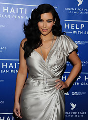 Kim Kardashian paired a layered diamond necklace with an asymmetrical gown for the Cinema for Peace event.