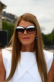Anna dello Russo arrived for the Christian Dior fashion show wearing a chic pair of butterfly sunnies.