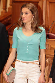 Princess Letizia styled a pair of white slacks with a skinny brown belt for an official function in Portugal.