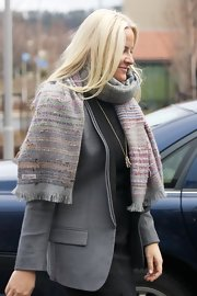 Princess Mette-Marit kept warm with a patterned scarf while visiting Arbeidsinstituttet.