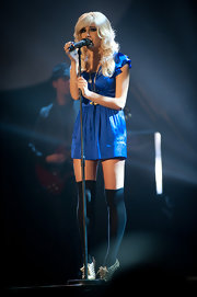 Pixie Lott styled her dress with black thigh-high socks and metallic brogues.