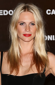Poppy Delevingne chose siren red lips to the Calzedonia Summer Show Forever Together.
