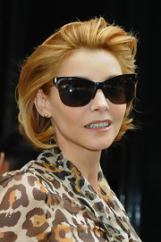 Clotilde Courau was spotted at the Dior Couture Fall 2009 show wearing a pair of cateye sunnies.