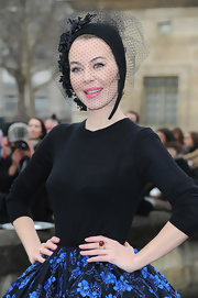 A veiled black floral fascinator finished off Ulyana Sergeenko's look in fancy style when she attended the Dior fashion show.