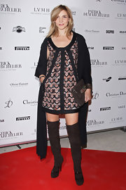 Clotilde Courau paired her frock with a black shawl.
