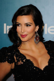 Kim Kardashian amped up the glamour with these ruby and diamond chandelier earrings during the InStyle Golden Globes party.