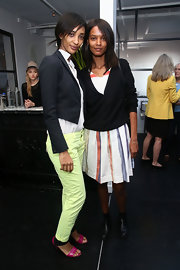 Liya Kebede layered a black cardigan over a striped dress for a preppy feel at the Women's Filmmaker Brunch.