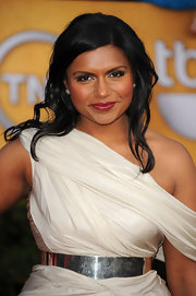 Mindy Kaling paired a broad silver belt with a white off-the-shoulder dress for the 2011 SAG Awards.