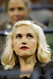 Gwen Stefani styled her hair into a wavy half-up 'do for day 10 of the U.S. Open.