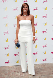 Christina Parodi lent contrast to her immaculate white outfit by choosing a midnight blue clutch.
