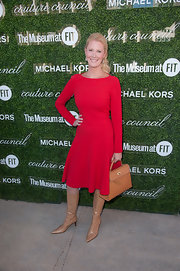 Sandra Lee's long-sleeve red dress and nude knee-high boots at the Couture Council Fashion Visionary Awards were a stylish pairing.
