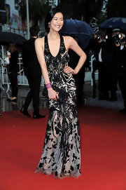 Liu Wen was the picture of sexy glamour in an intricately beaded, sheer Roberto Cavalli gown during the 'Amour' Cannes premiere.