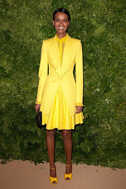 Liya Kebede kept up the yellow theme with a pair of ankle-strap sandals.