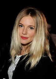 Sienna Miller finished off her look with a crimson lip.