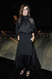 Carine Roitfeld was goth-glam at Le Bal in a sheer black Givenchy gown featuring a bow-adorned high neckline and a ruffled hem.