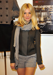 Sienna Miller sported a gray scarf, jacket, and shorts combo, all by Rag & Bone, during the brand's Soho store opening.