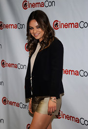 Mila Kunis blinged up with some gold bracelets for CinemaCon 2012.