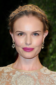 Kate Bosworth avoided looking washed out by swiping on some bold pink lipstick.