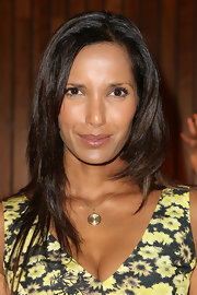 Padma Lakshmi accessorized with a classic gold pendant necklace.