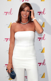 Cristina Parodi flaunted her golden tan in a long white tube top as she attended Presentazione Palinsesti LA7 Autuno 2012.