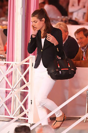 Charlotte Casiraghi completed her look with a stylish black leather tote.