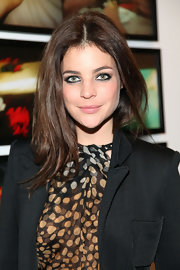 Julia Restoin-Roitfeld attended a photography exhibition wearing her hair with a center part and flippy ends.