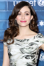 Emmy Rossum went for an ultra-feminine vibe with this curly 'do and floral dress combo at the pre-Oscar charity brunch.