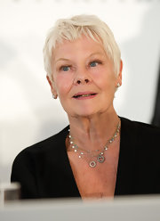 Judi Dench stayed cool with this pixie at the Praemium Imperiale Japanese Awards.