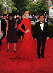 Liu Wen made a grand entrance in a flowing crimson Michael Kors gown during the Met Gala.