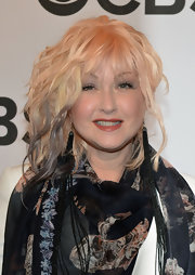 Cyndi Lauper definitely looked unique wearing an uber long pair of fringed bead earrings at the Tony Awards.