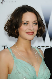 Marion Cotillard looked adorable wearing this curled-out bob at the amfAR Cinema Against AIDS Gala.