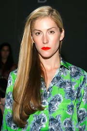 Joanna Hillman left her long hair loose with a side part for the Trias fashion show.