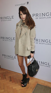 Caroline Sieber accessorized her coat with a chic black quilted bag by Chanel.
