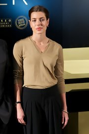Charlotte Casiraghi jazzed up her look with some gold bangles for the 'El Arte de Cartier' exhibition opening.