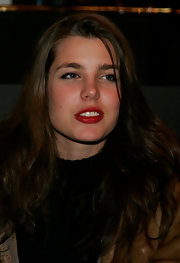 Charlotte Casiraghi kept her beauty look simple except for a bold red lip at the Lagerfeld Confidential party.
